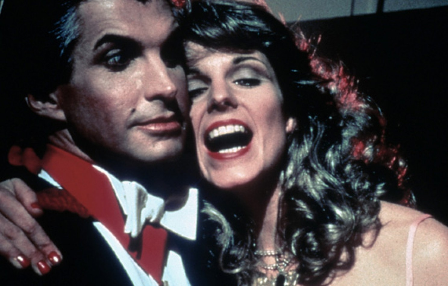 Count Dracula (George Hamilton) and his reincarnated lady love (Susan St James) in Love at First Bite (1979)