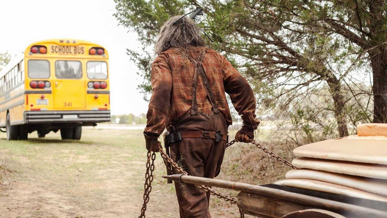 Undead lumberjack Nehemiah Easterday (Brandon Ford) follows the school bus dragging his cart of giant pancakes in Lumberjack Man (2015)