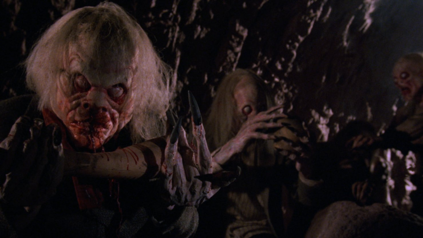 The creatures lurking beneath the graveyard in Lurking Fear (1994)