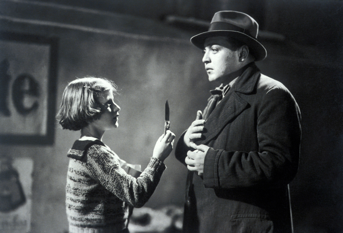 Peter Lorre approaches a child victim in M (1931)
