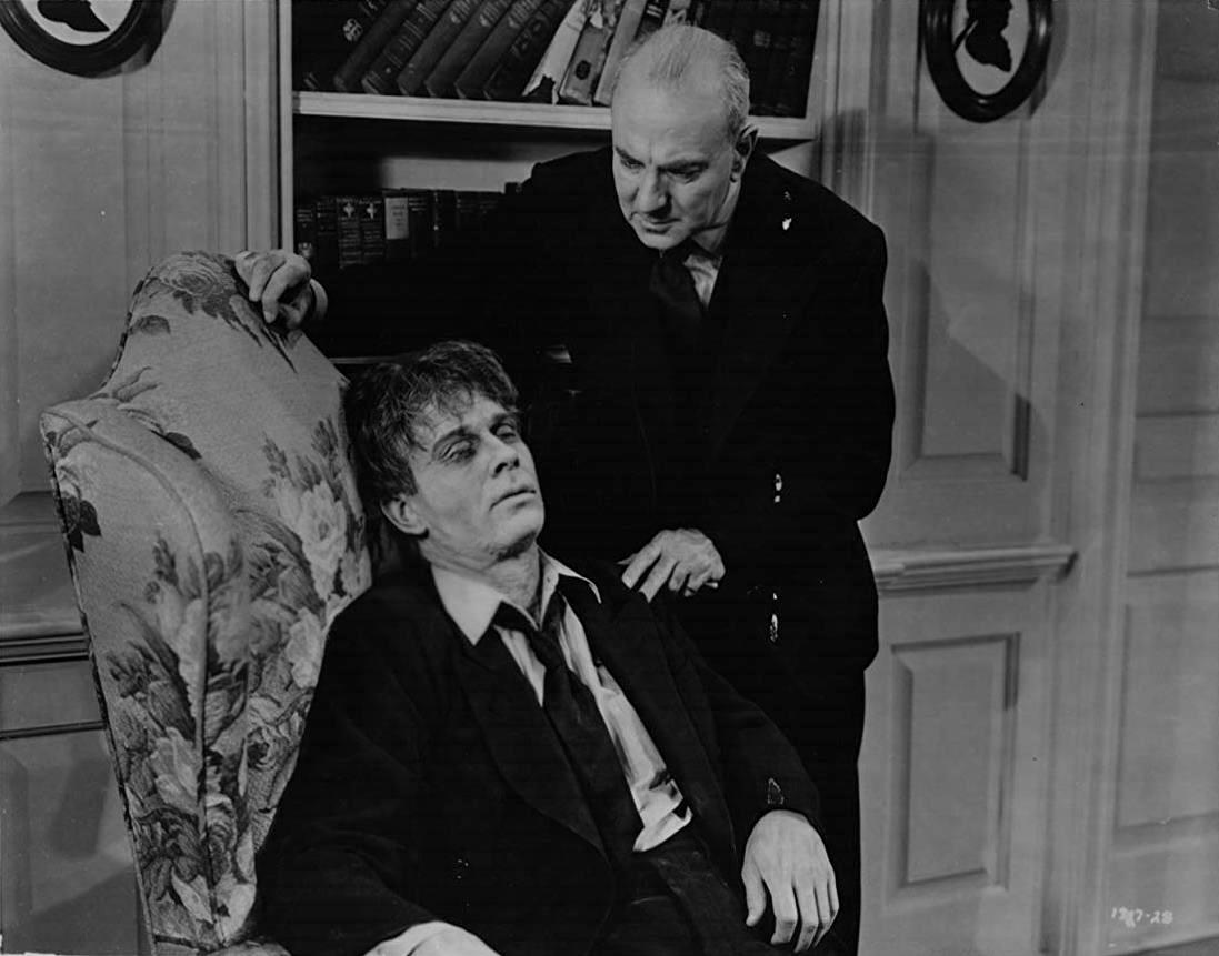 Mad scientist George Zucco and his zombified lab assistant David Bruce in The Mad Ghoul (1943)