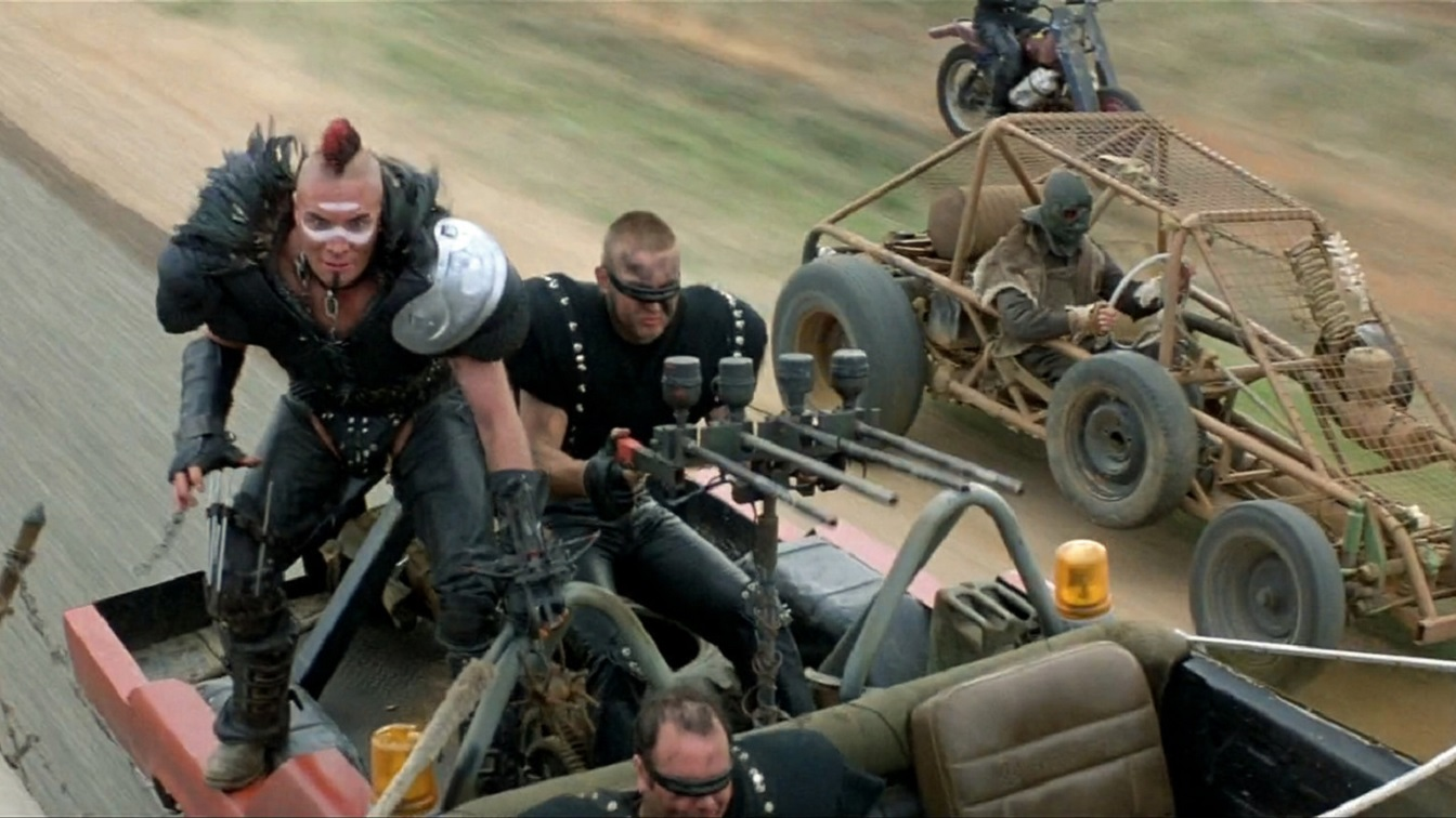 Wasteland crazies led by Wez (Vernon Wells) attempt to board the tanker in Mad Max 2 (1981)
