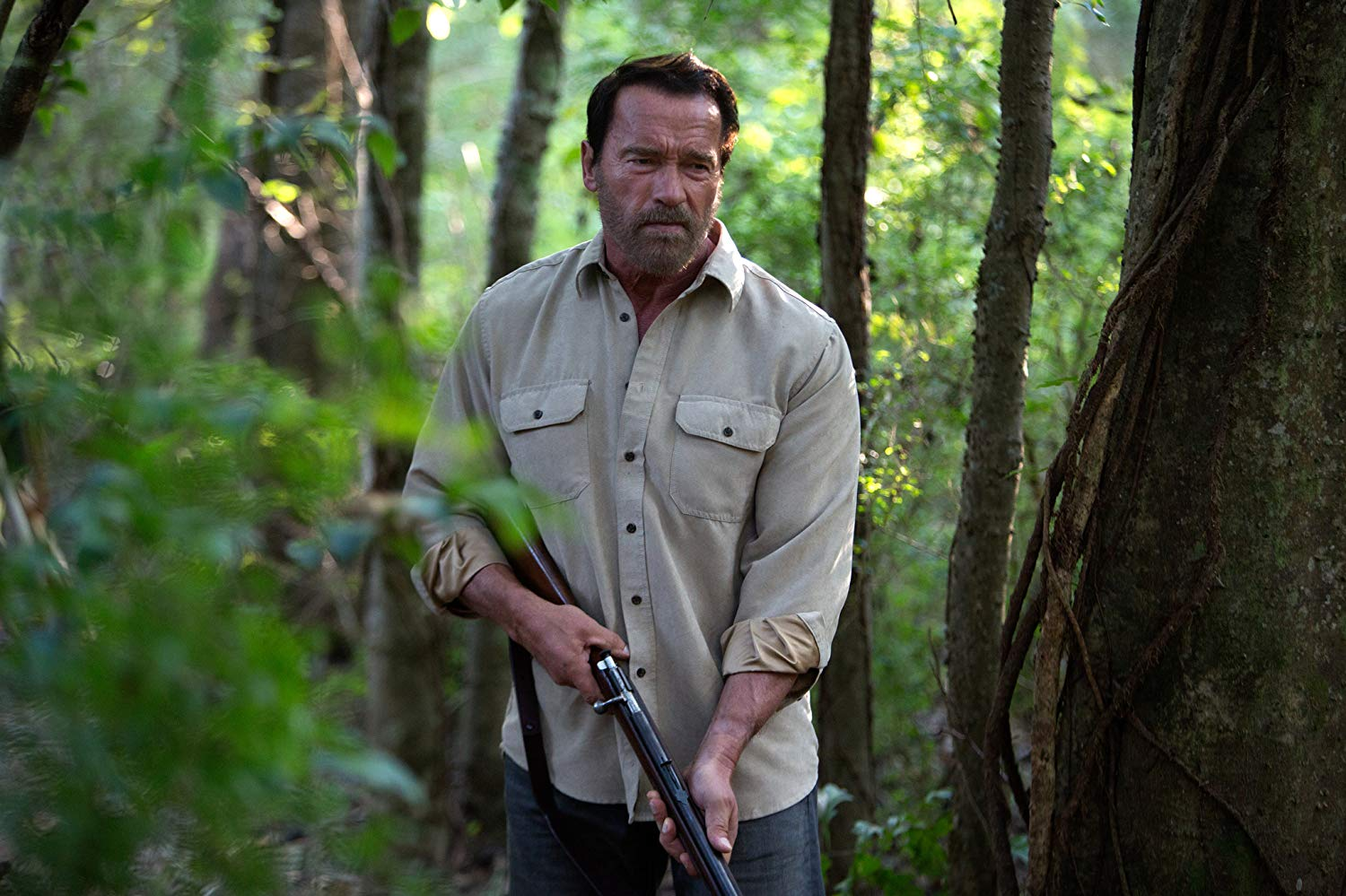 Arnold Schwarzenegger wielding shotgun, although in a role that sees him sidestep action man heroism for acting in Maggie (2015)