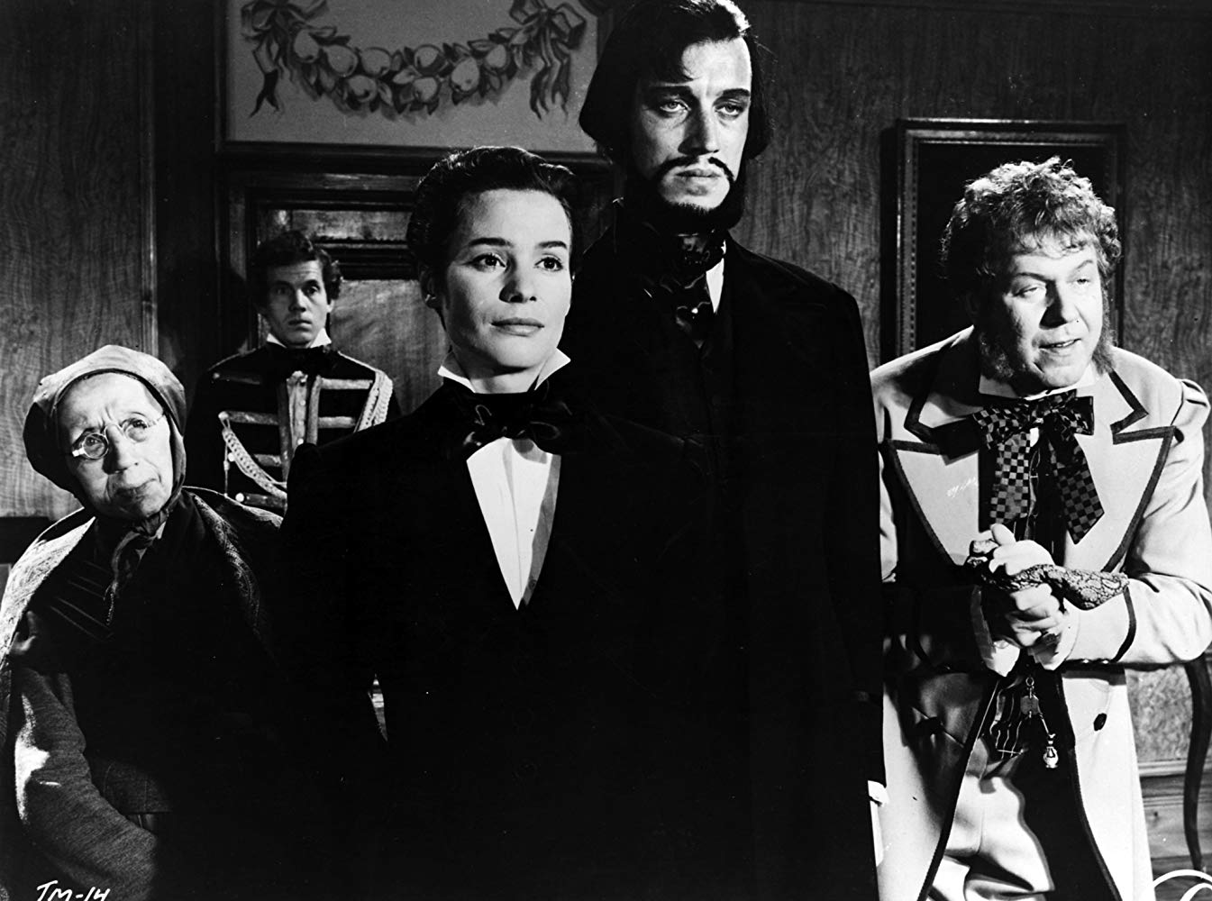 The arrival of Vogler's Magnetic Health Theater - (l to r) Granny (Naima Wifstrand), Manda (Ingrid Thulin), Vogler (Max Von Sydow) and Tubal (Åke Fridell) in The Magician (1958)