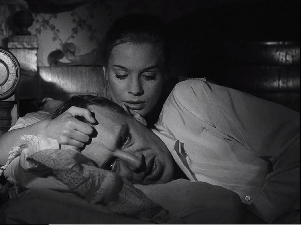 The sickly Vogler (Max Von Sydow) comforted by wife Ingrid Thulin in The Magician (1958)