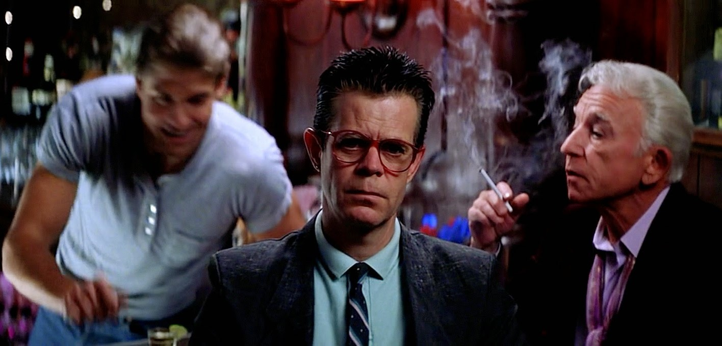 William H. Macy (c) with a case of unrequited love for barman Craig Kyinsland (l) and flanked by Henry Gibson (r) in Magnolia (1999)