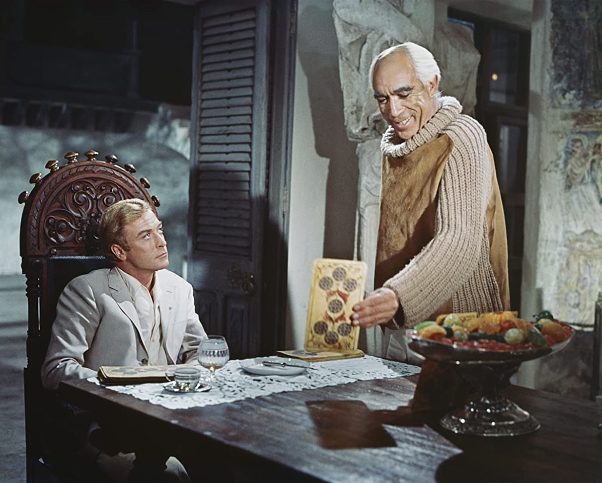 Nicholas Urfe (Michael Caine) at the centre of a series of reality games put on by Maurice Colchis (Anthony Quinn) in The Magus (1968)