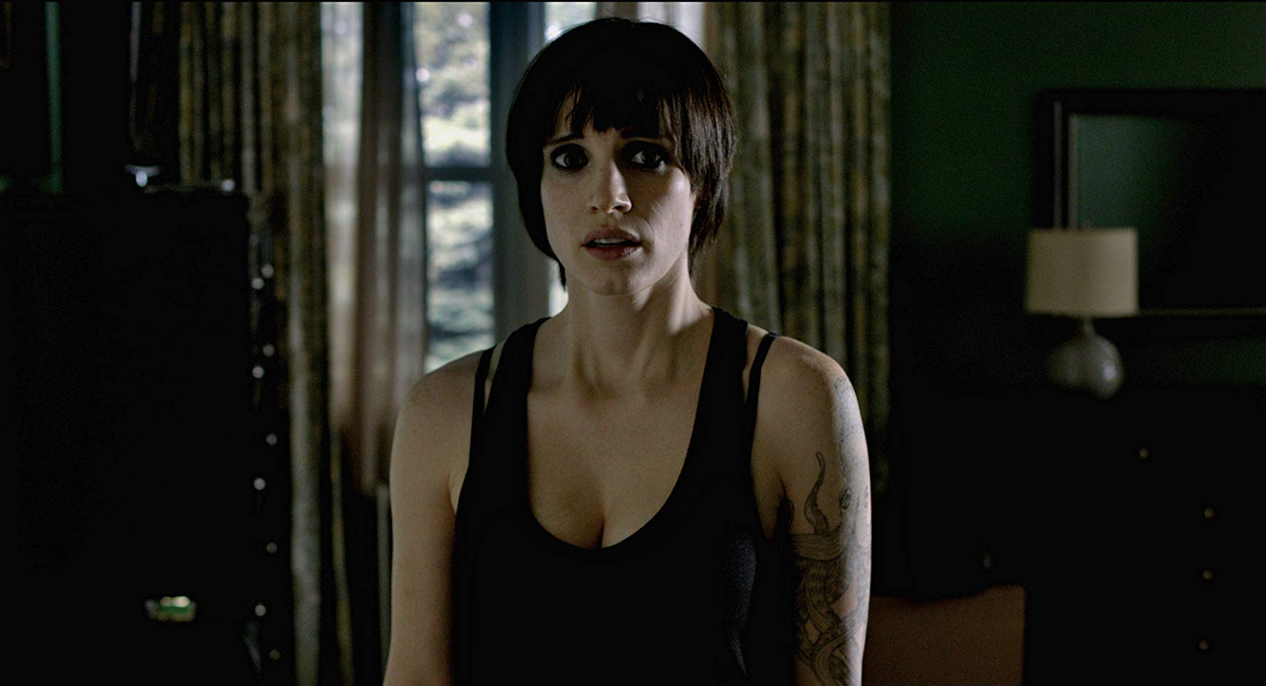 An unrecognisably black-haired and gothed-out Jessica Chastain in Mama (2013)