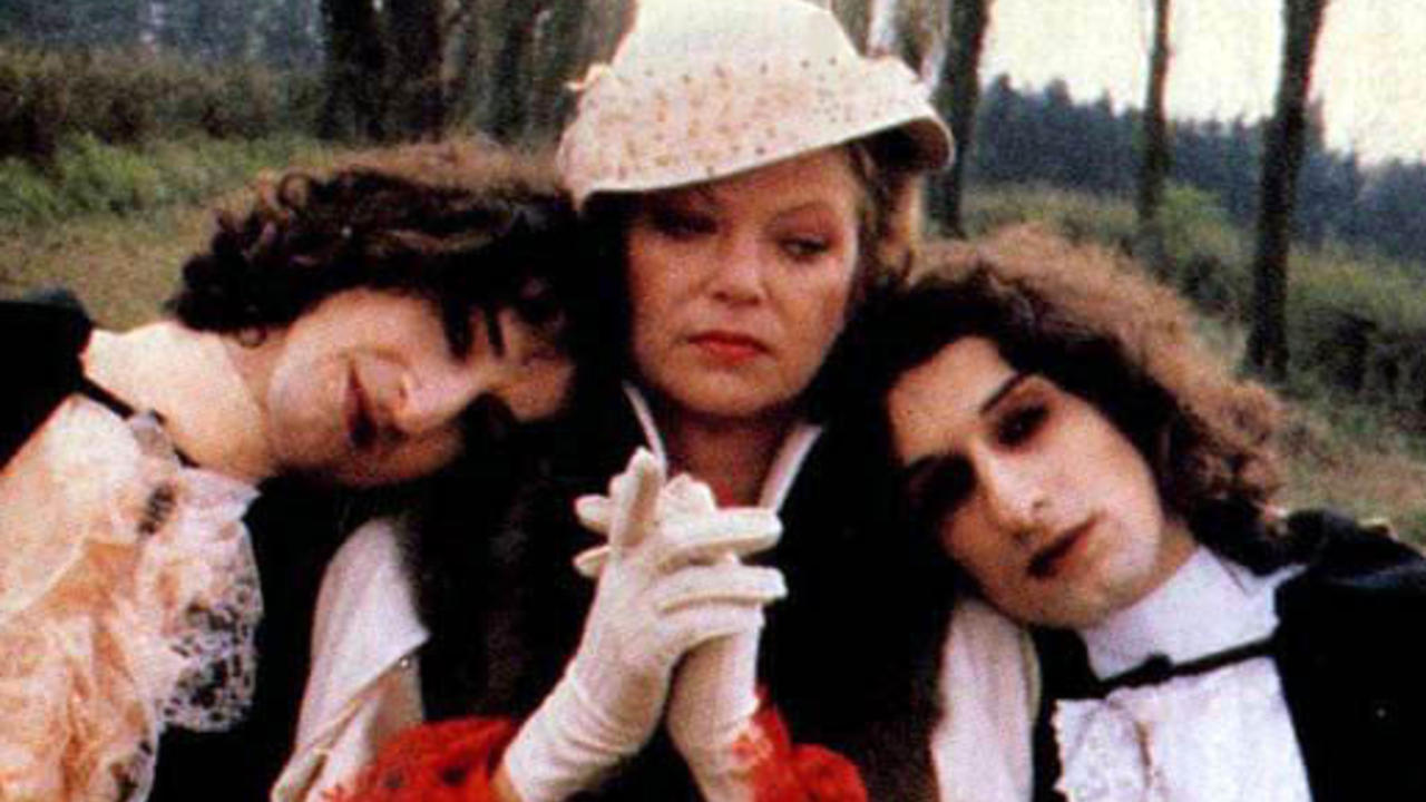 Countess Dracula (Louise Fletcher) flanked by sons Vladimir and Ladislas (twins Marc-Henri and Alexandre Wajnberg) in Mama Dracula (1980)