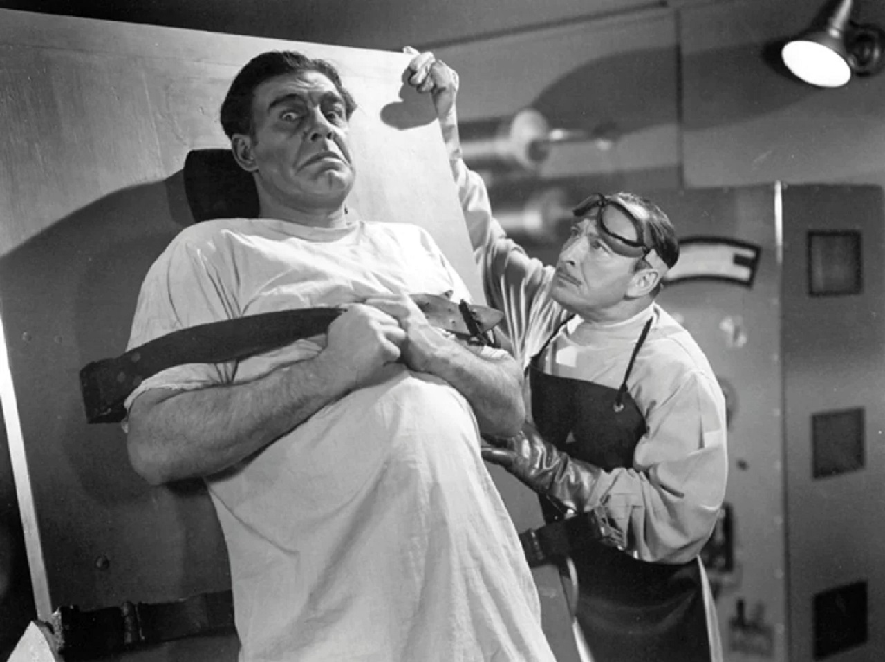 Lionel Atwill prepares to experiments on Lon Chaney Jr in Man-Made Monster (1941)