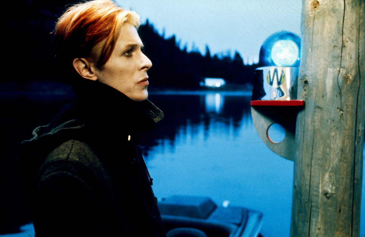 David Bowie as Thomas Jerome Newton, an alien visitor newly arrived on Earth in The Man Who Fell to Earth (1976)