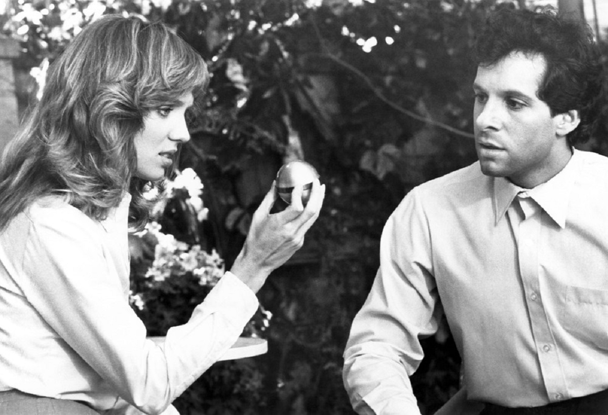 Lia Langlois, Steve Guttenberg with the sphere of invisibility serum in The Man Who Wasn't There (1983)