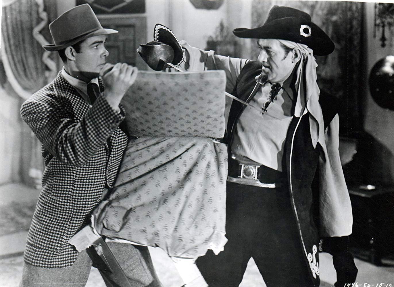 (l to r) Criminologist Lance Reardon (Richard Bailey) fights the villainous Captain Mephisto (Roy Barcroft) in Manhunt of Mystery Island (1945)