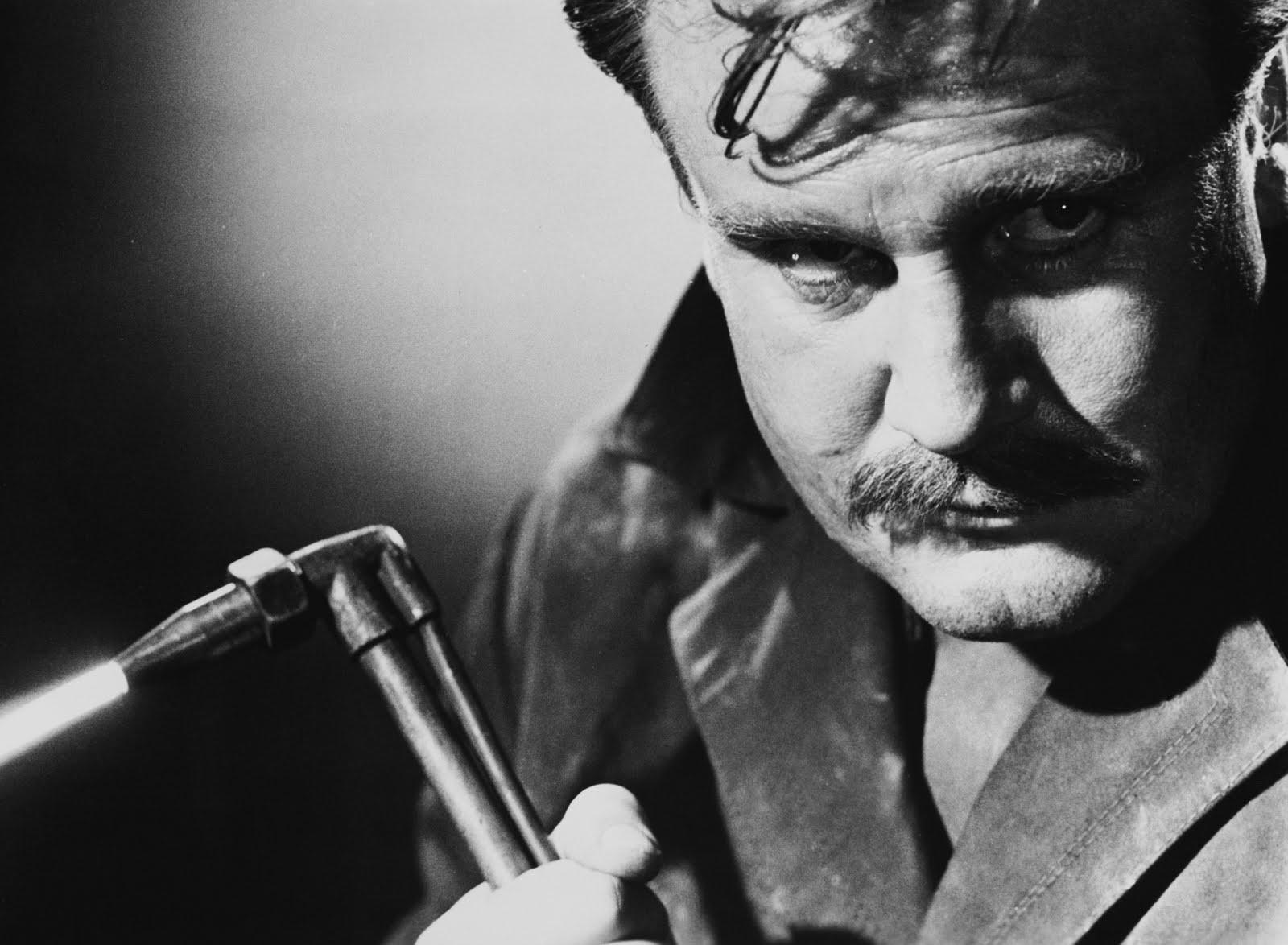 A blowtorch-wielding Georges (Donald Houston) returns seeking revenge in Maniac (1963)
