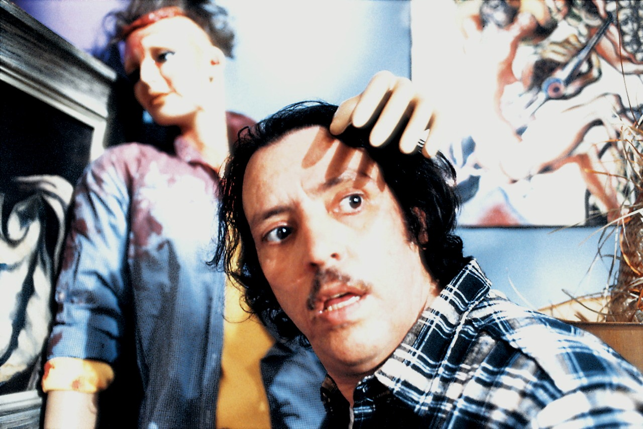 Joe Spinell as Frank Zito along with mannequins in Maniac (1980)
