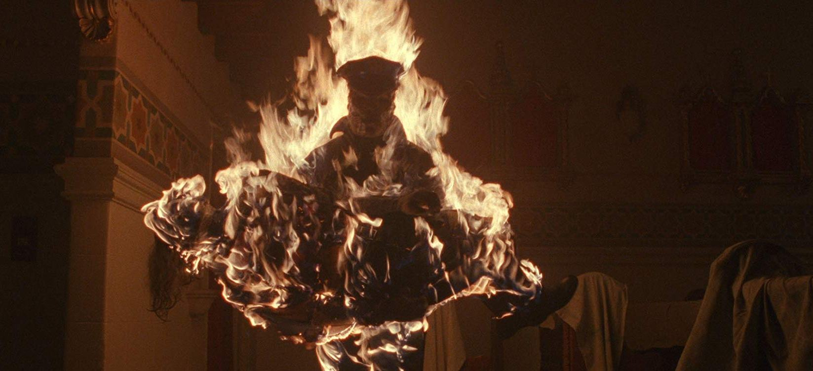 Matt Cordell (Robert Z'dar) carries off Gretchen Baker in flames in Maniac Cop 3 Badge of Silence (1992)