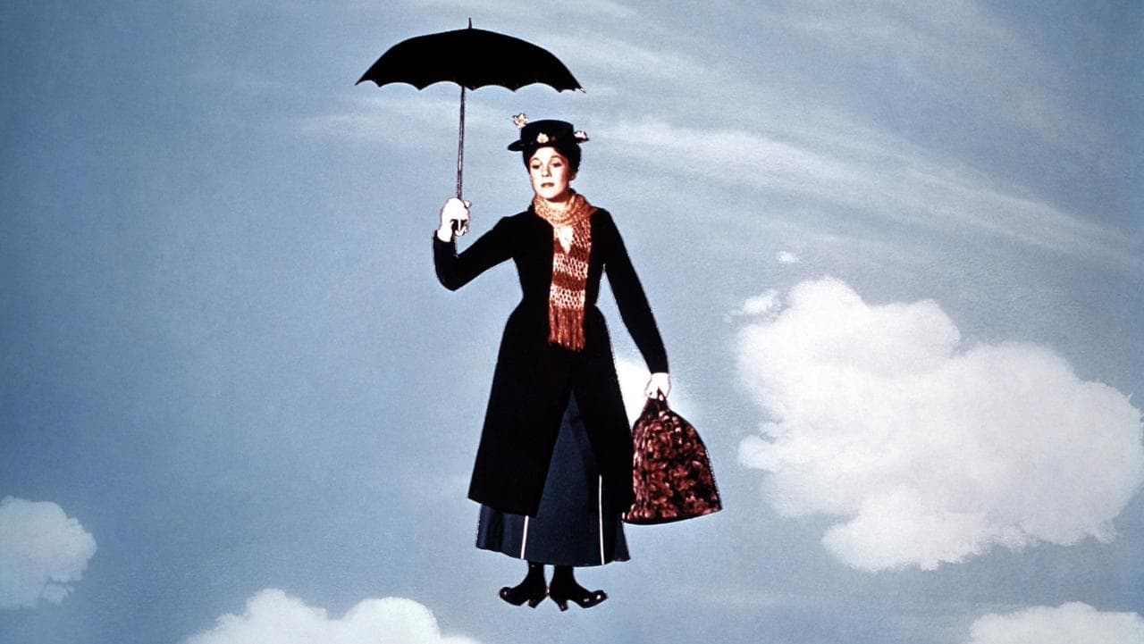 Mary Poppins (Julie Andrews) arrives, blown in on the wind by her umbrella in Mary Poppins (1964)