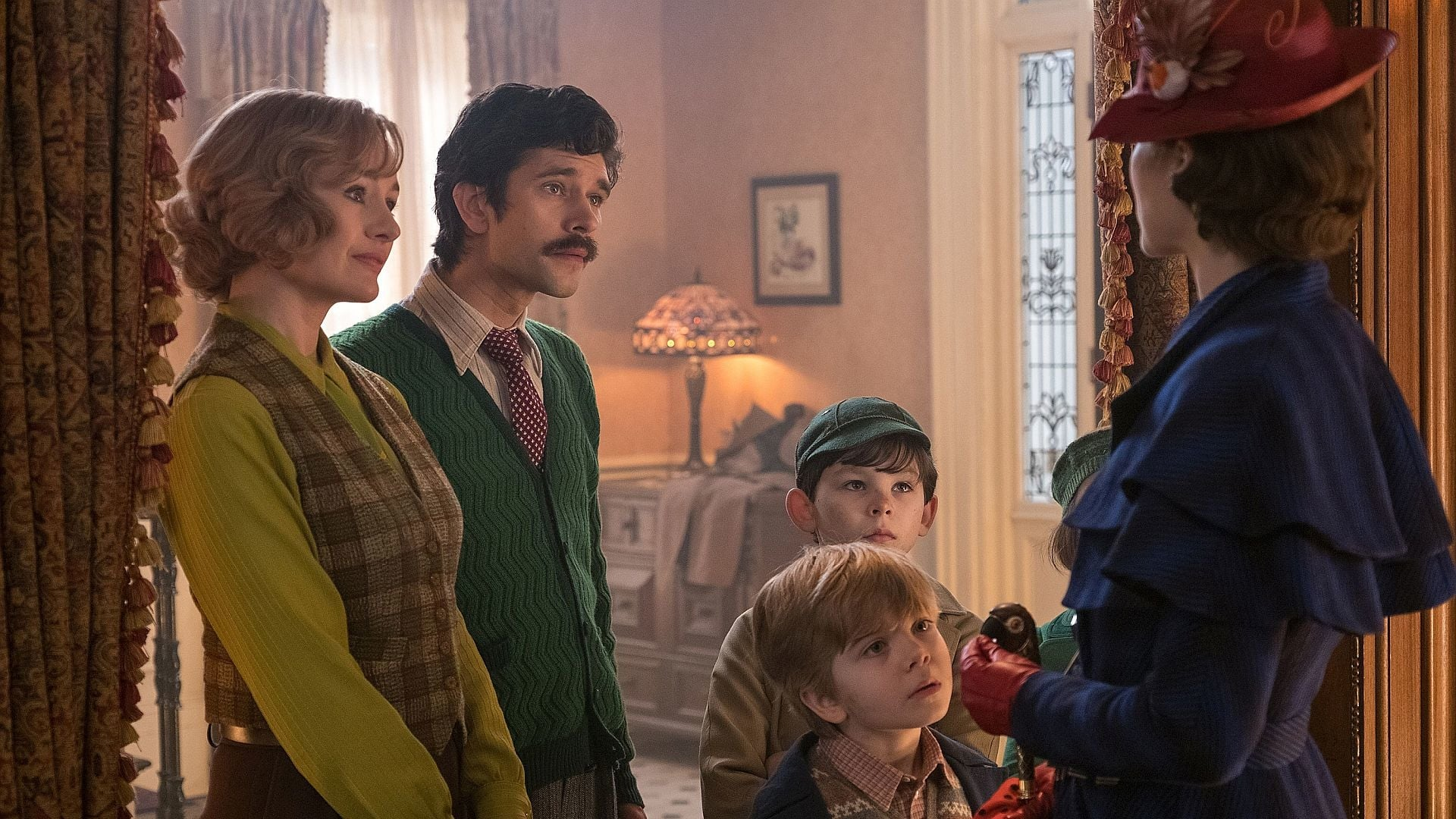 (l to r) The grown-up Banks children Jane (Emily Mortimer) and Michael (Ben Whishaw), his children Georgie (Joel Dawson) and John (Nathaniel Saleh), and Mary Poppins (Emily Blunt) in Mary Poppins Returns (2018)