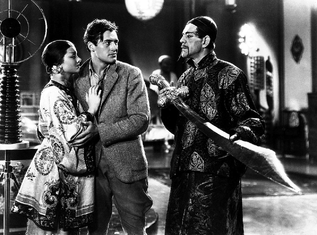 Charles Starrett protects Fah Lo See (Myrna Loy) from Fu Manchu (Boris Karloff) in The Mask of Fu Manchu (1932)
