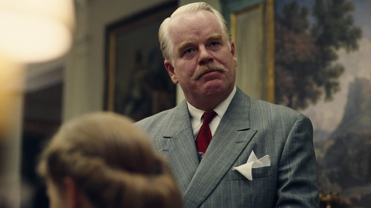 Philip Seymour Hoffman as Lancaster Dodd loosely based on L. Ron Hubbard in The Master (2012)