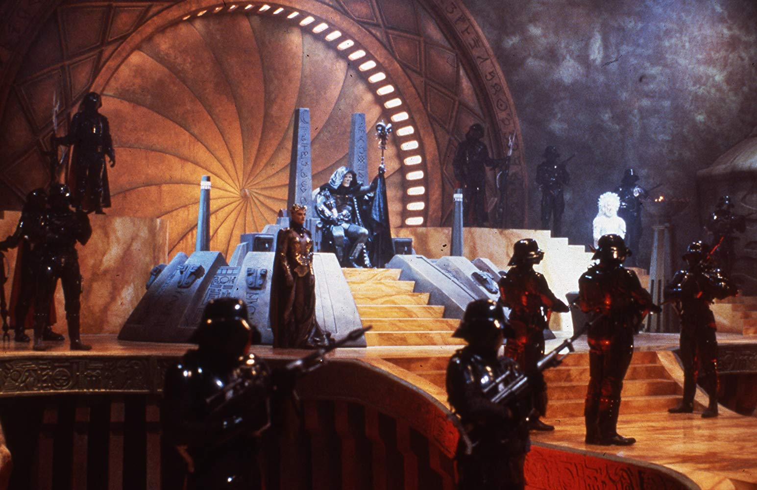 The superb sets for the film. Skeletor's throne room with Skeleteor (Frank Langella) seated and Evil-Lyn (Meg Foster) stand to his left in Masters of the Universe (1987)