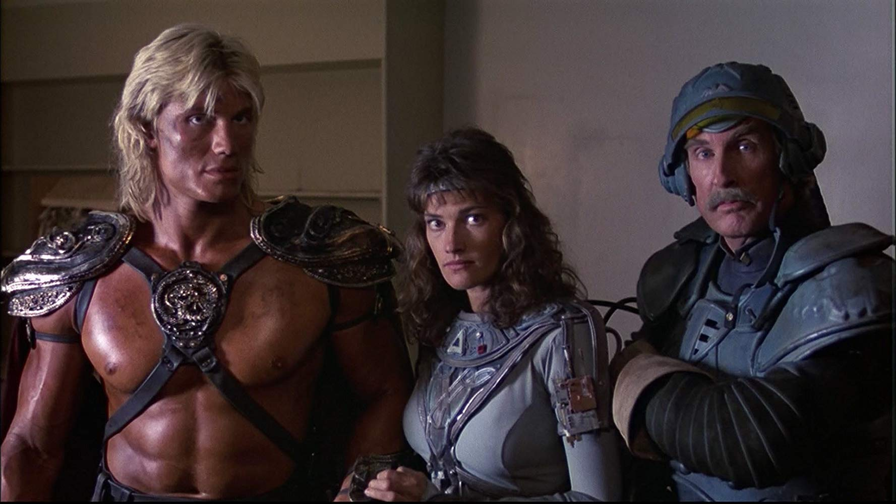 (l to r) He-Man (Dolph Lundgren), Teela (Chelsea Field) and Man-At-Arms (Jon Cypher) in Masters of the Universe (1987)