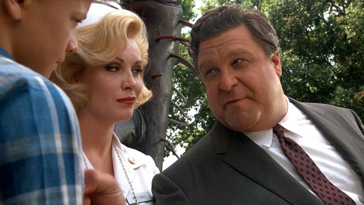 (l to r) Young Simon Fenton, actress Cathy Moriarty and John Goodman as Lawrence Woolsey, the film's homage to William Castle in Matinee (1993)