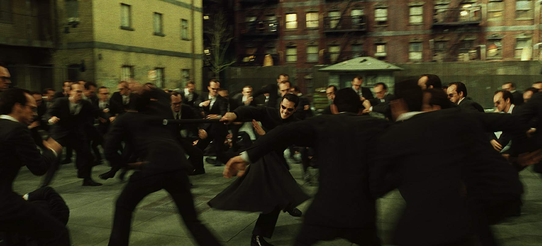 Neo (Keanu Reeves) vs hundreds of Agent Smiths (Hugo Weaving) in The Matrix Reloaded (2003)