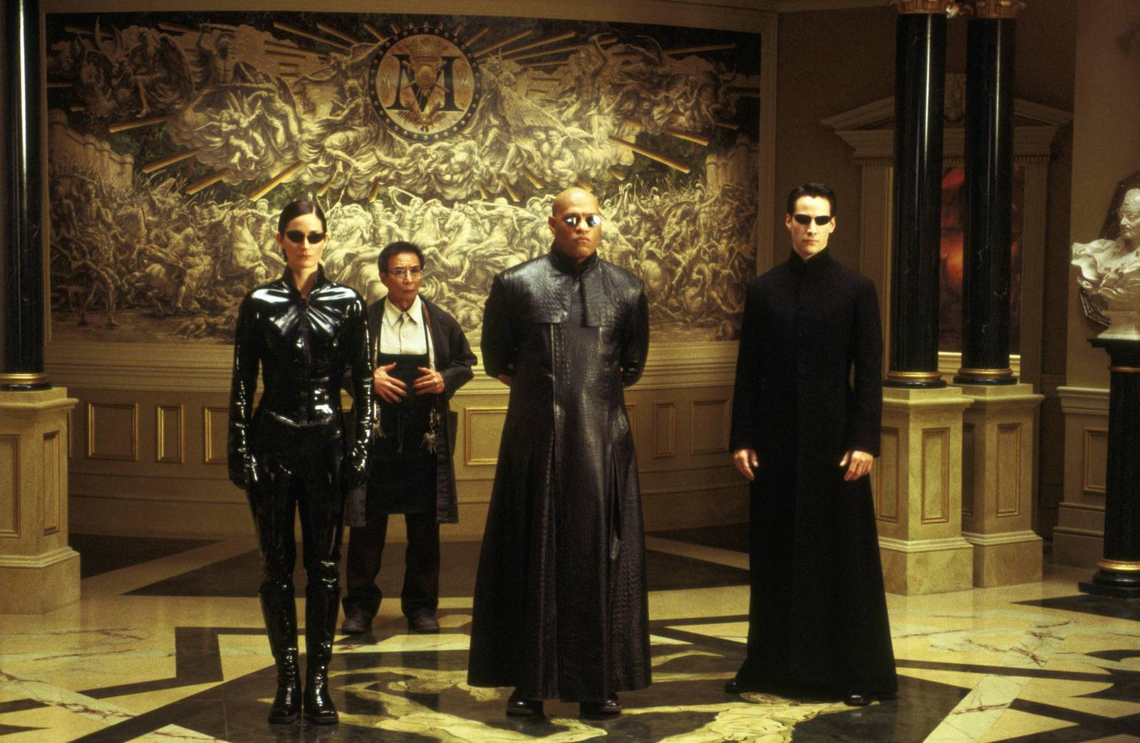 Character ine-up - (l to r) Trinity (Carrie-Anne Moss), The Keymaker (Randall Duk Kim), Morpheus (Laurence Fishburne) and Neo (Keanu Reeves) in The Matrix Reloaded (2003)