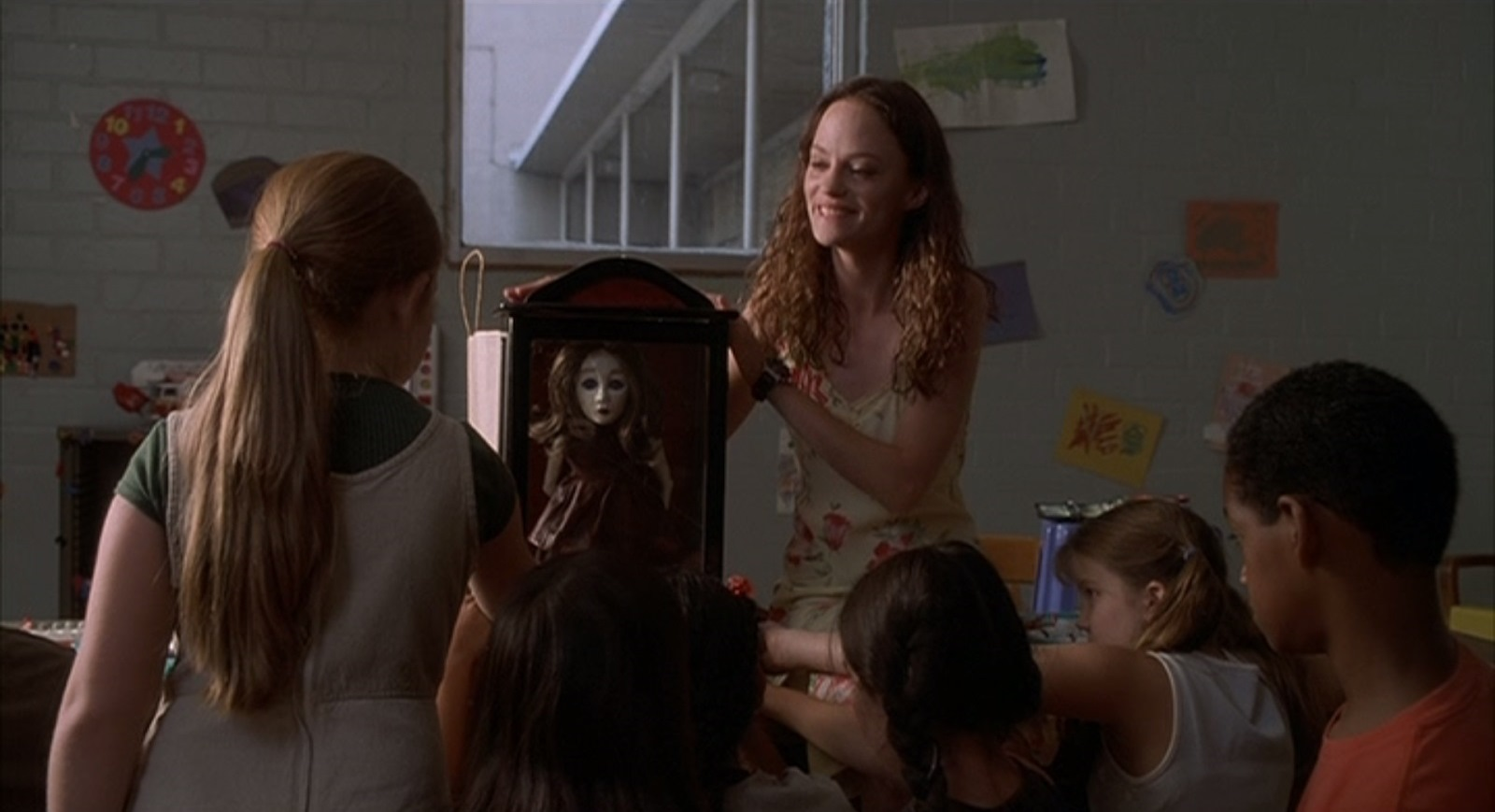 Angela Bettis shows her doll Suzie to the class of children in May (2002)