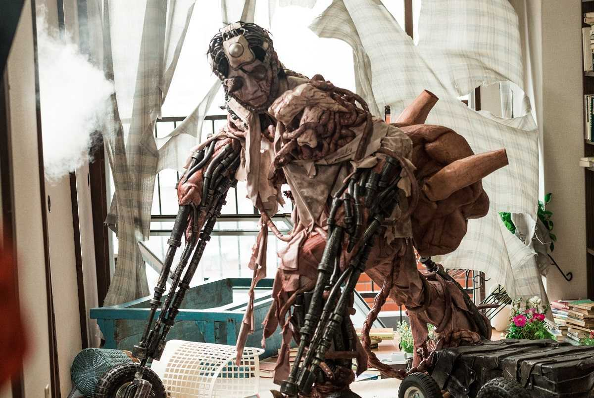 Masanori Mimoto transformed into a bio-mechanoid vehicle in Meatball Machine: Kodoku (2017)