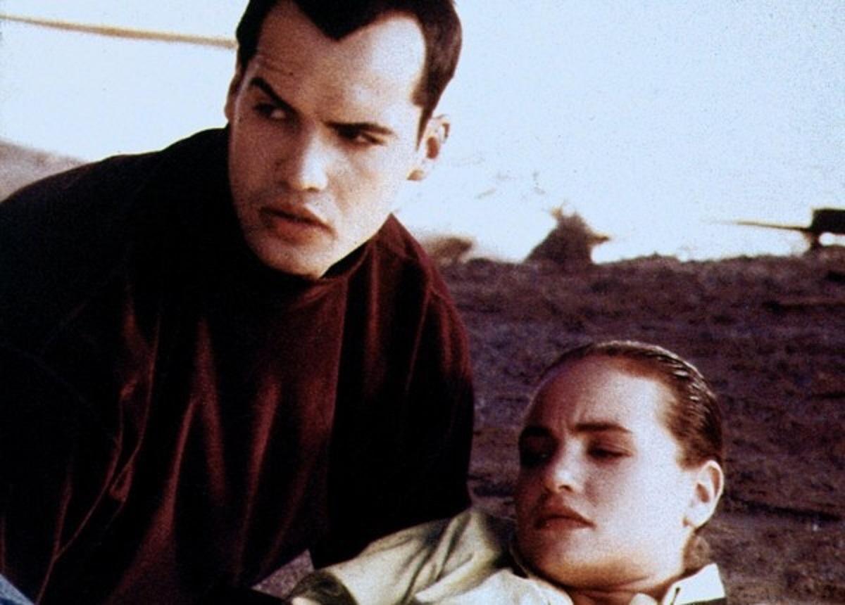 Billy Zane and Kristen Cloke in Megaville (1990)