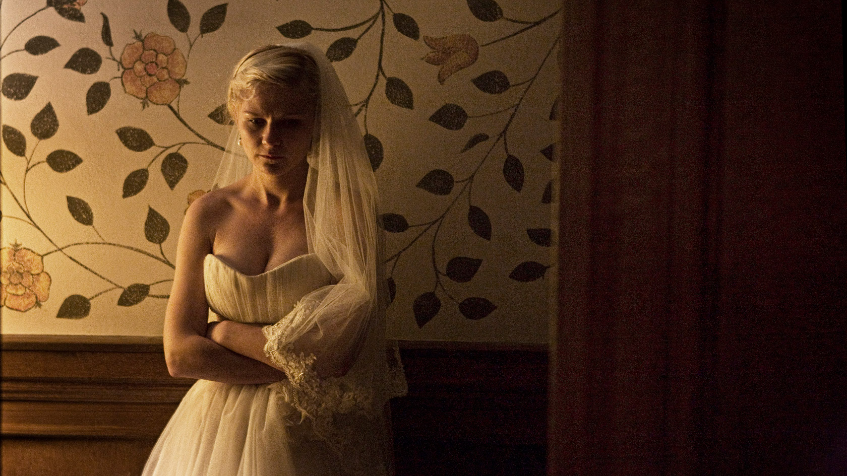 Kirsten Dunst falls into deep depression on her wedding day in Melancholia (2011)