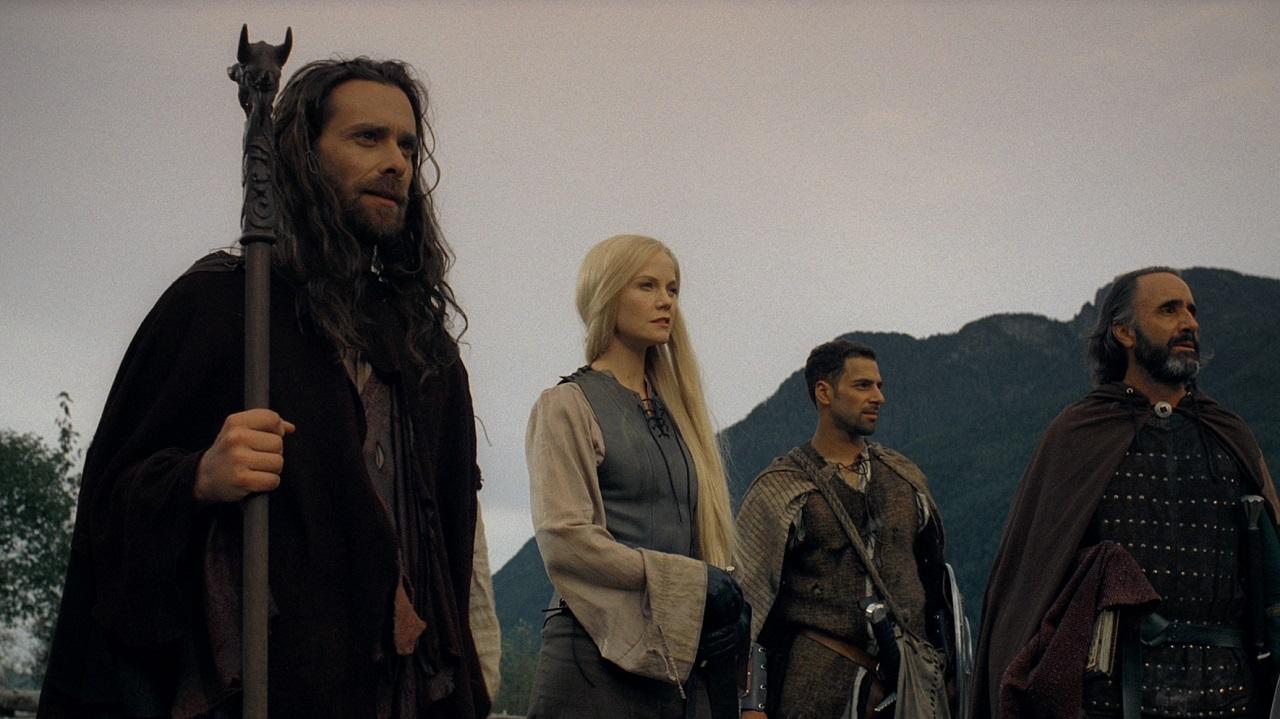 Merlin (James Callis), King Arthur's daughter Avlynn (Laura Harris), Tristan (Patrick Sabongui) and Sir Galahad (Donald Adams) in Merlin and the Book of Beasts (2008)