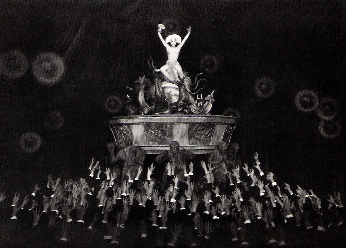 The android Maria (Brigitte Helm) stirs the worker's with an erotic dance in Metropolis (1927)