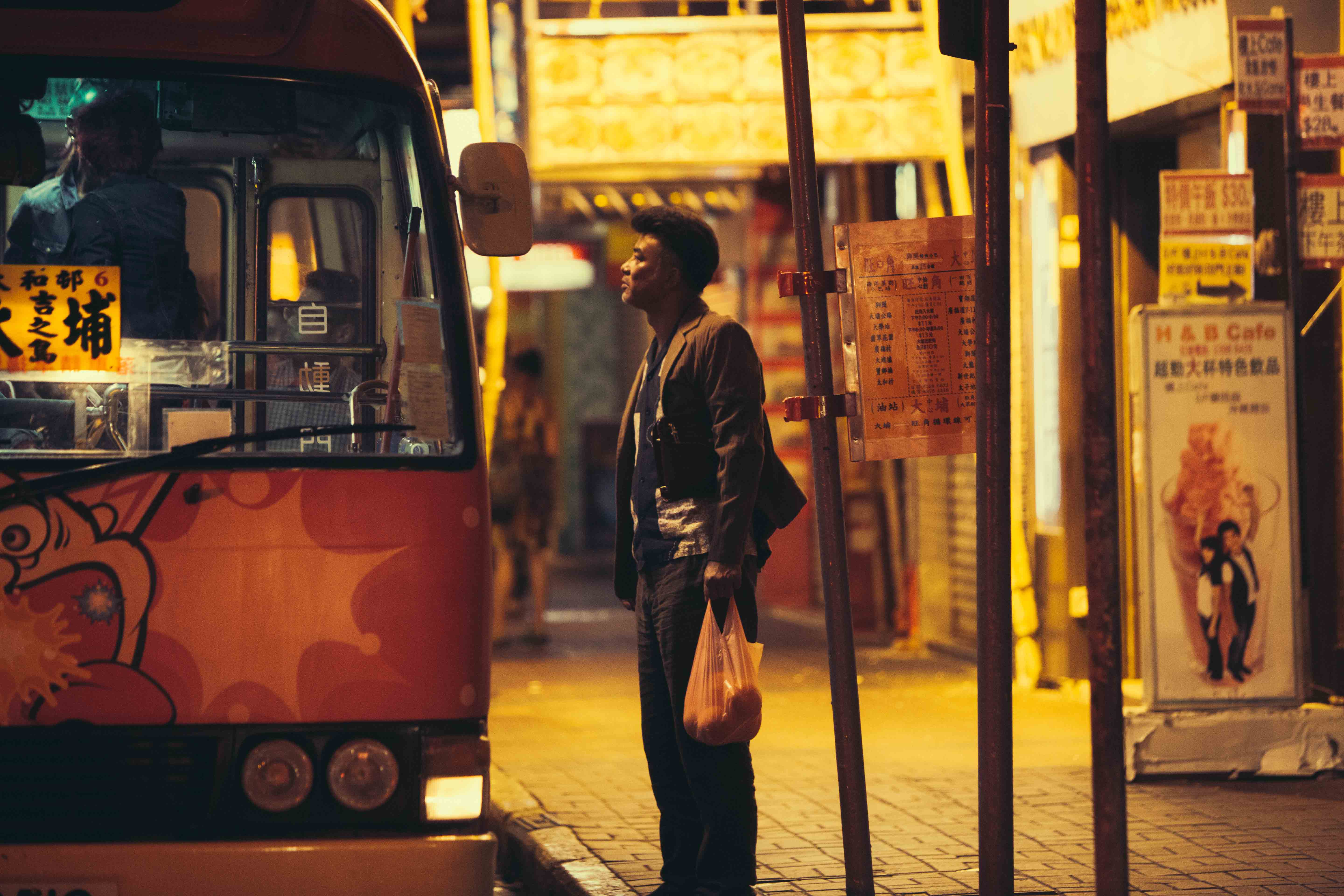 Boarding the bus to Tai Po Road in The Midnight After (2014)