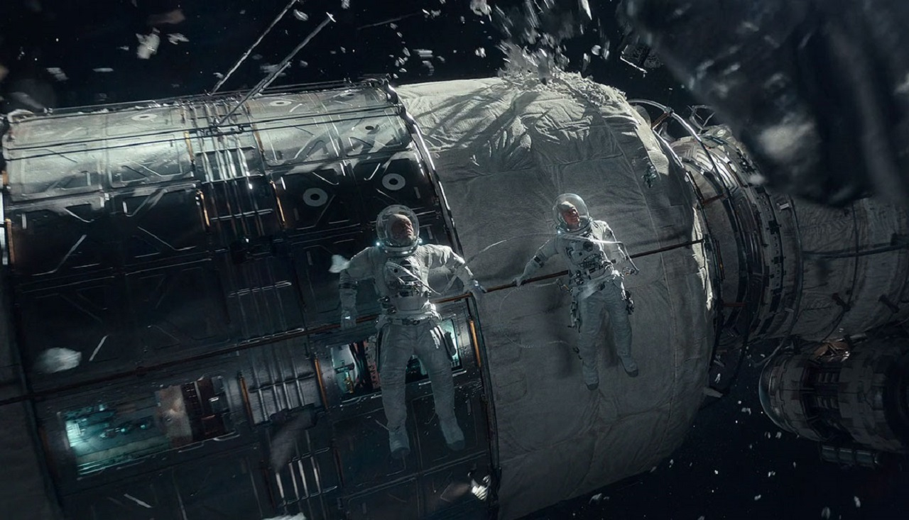 The crew of the Aether encounter space debris in The Midnight Sky (2020)