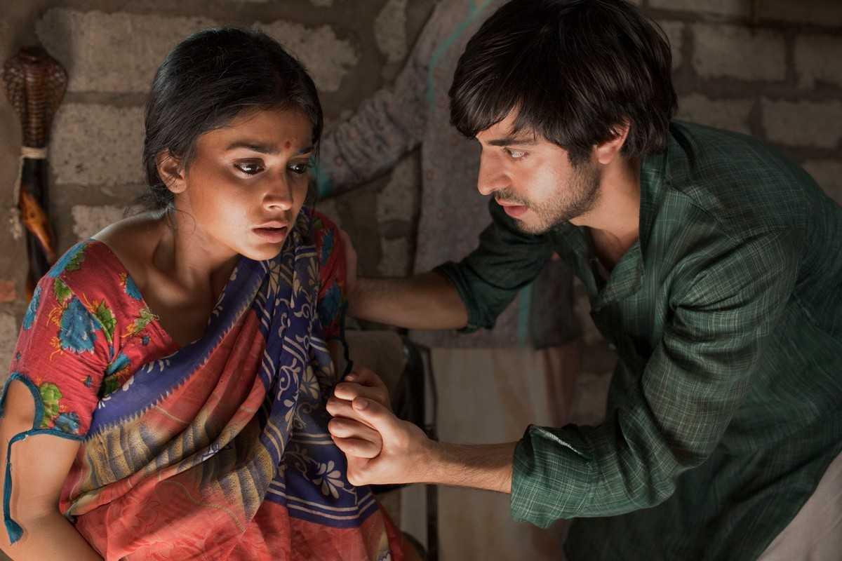 Satya Babha as Saleem Sinai, the poor child swapped at birth, with his love Parvati (Shriya Saran) in Midnight's Children (2012)