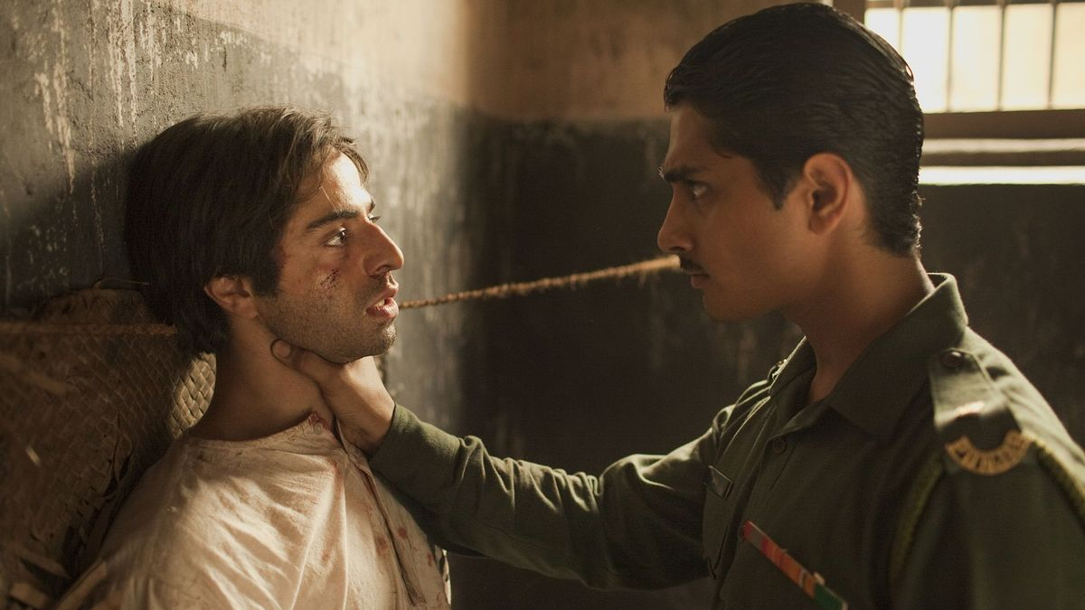 (l to r) Saleem Sinai (Satya Babha) threatened by Shiva (Siddharth), the child he was swapped at birth with grown up as a harsh military officer in Midnight's Children (2012)