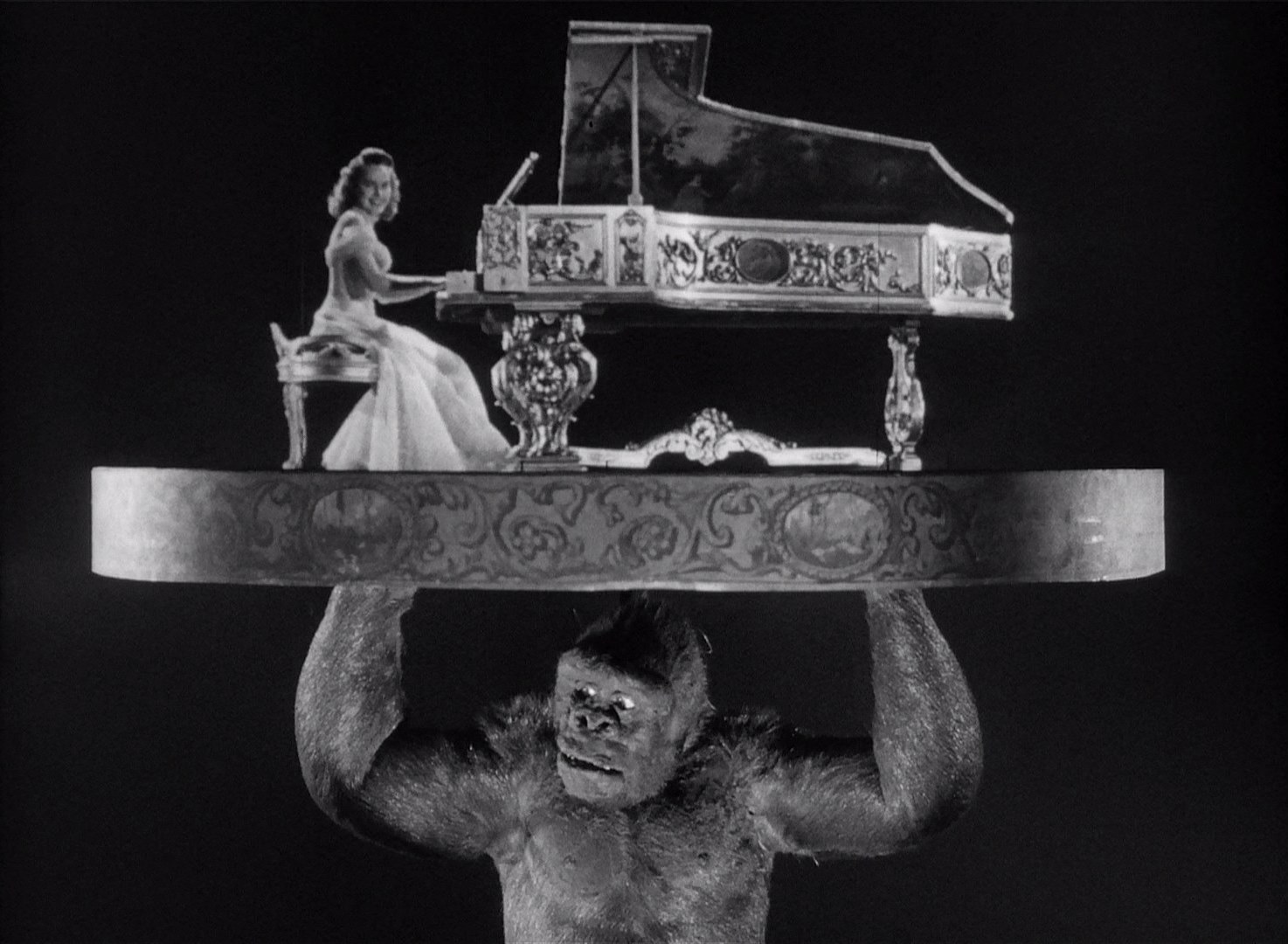 Joe lifts Terry Moore above his head as she plays Beautiful Dreamer in Mighty Joe Young (1949)
