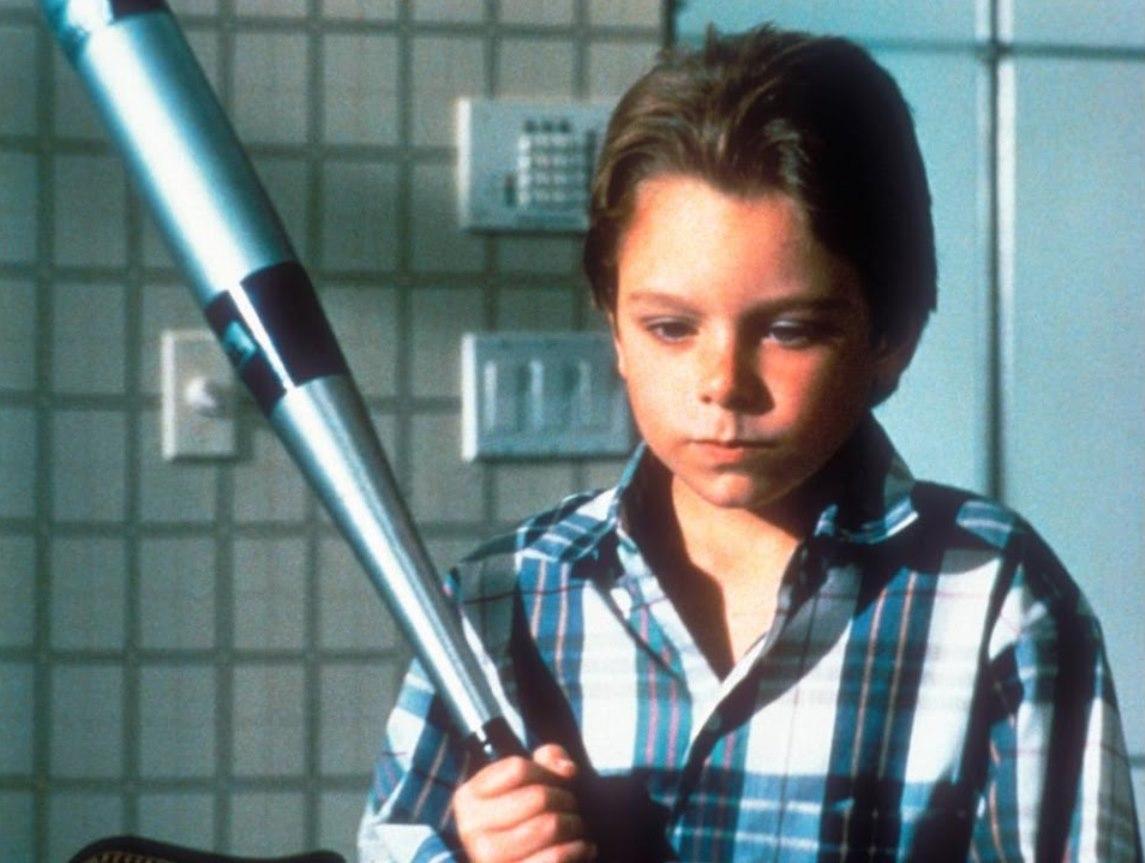 Brian Bonsall as Mikey with baseball bat