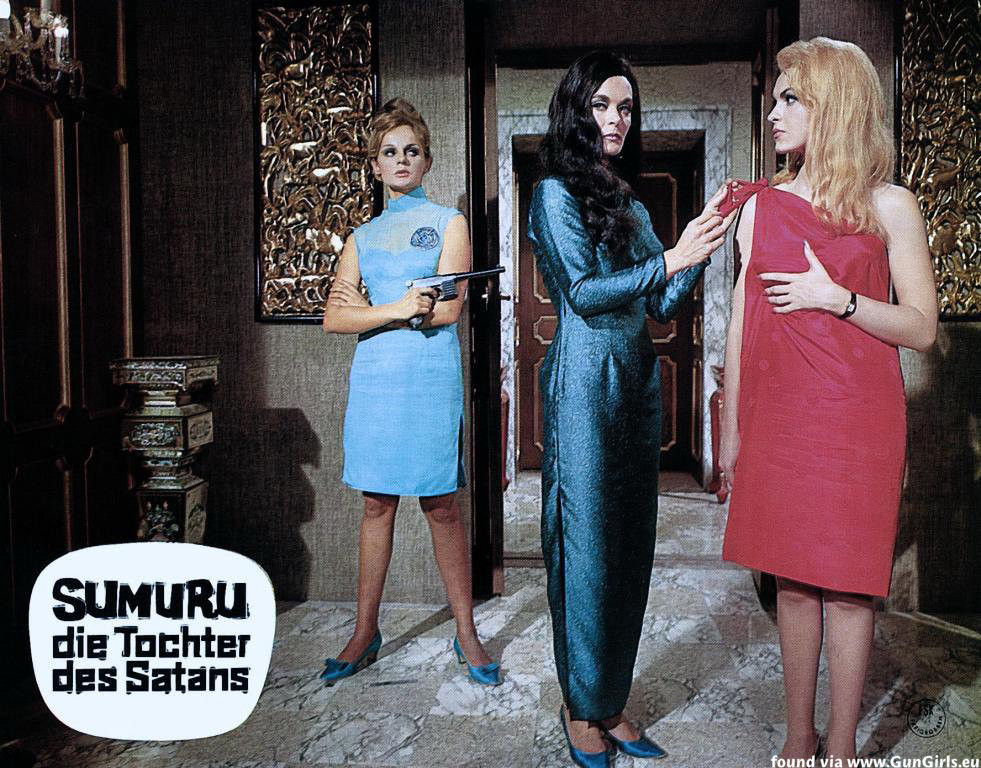 The female super-villain Sumuru (Shirley Eaton) (c) introduces her agent Maria Rohm (r) in The Million Eyes of Sumuru (1967)