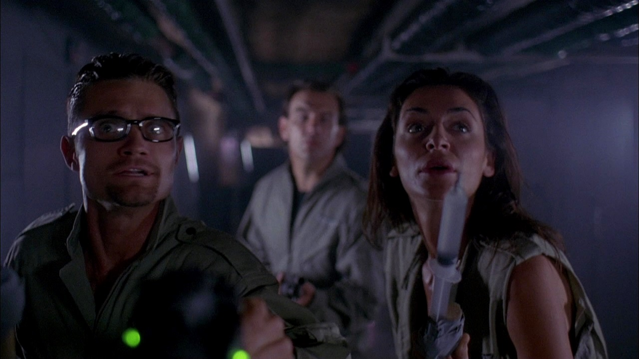 Gregory Sporleder, John Diehl and Claire Stansfield in Mind Ripper (1995)