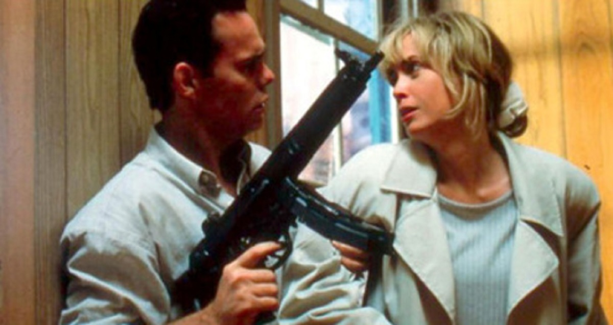 Sperm donor Kevin Dillon holds recipient mother Lysette Anthony at gunpoint in Misbegotten (1997)