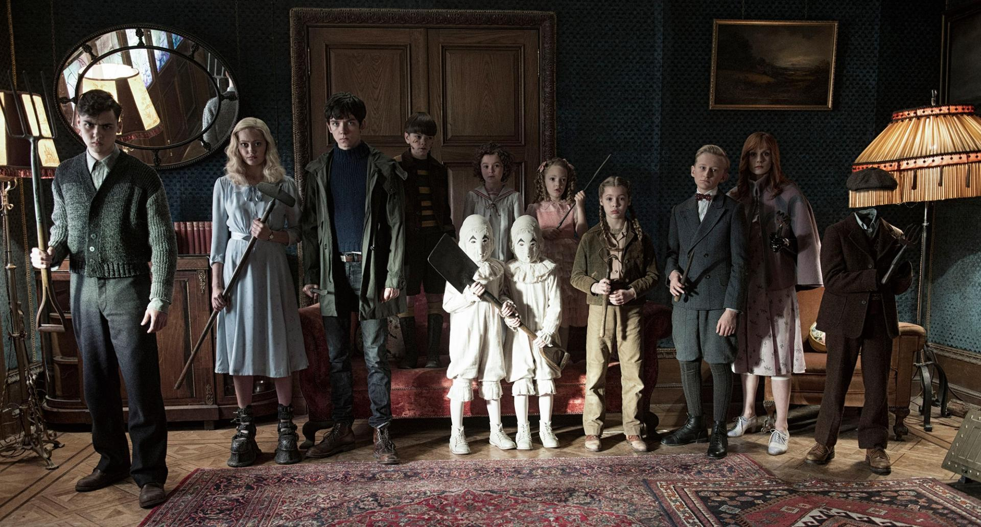 The Peculiar Children - (l to r) Enoch O'Connor (Finlay MacMillan), Emma Bloom (Ella Purnell), Jake Portman (Asa Butterfield), Hugh Apiston (Milo Parker), The Twins (Joseph Odwell and Thomas Odwell), Bronwyn Bruntley (Pixie Davies), Claire Densmore (Raffiella Chapman), Fiona Frauenfeld (Georgia Pemberton), Horace Somnusson (Hayden Keeler-Stone), Olive Abroholos Elephanta (Lauren McCrostie) and Millard Nullings (Cameron King) in Miss Peregrine's Home for Peculiar Children (2016)