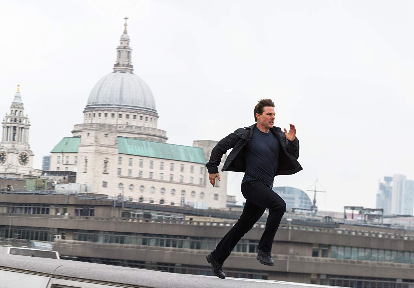 Ethan Hunt (Tom Cruise) back in action in a furious chase across the rooftops of London in Mission: Impossible - Fallout (2018)
