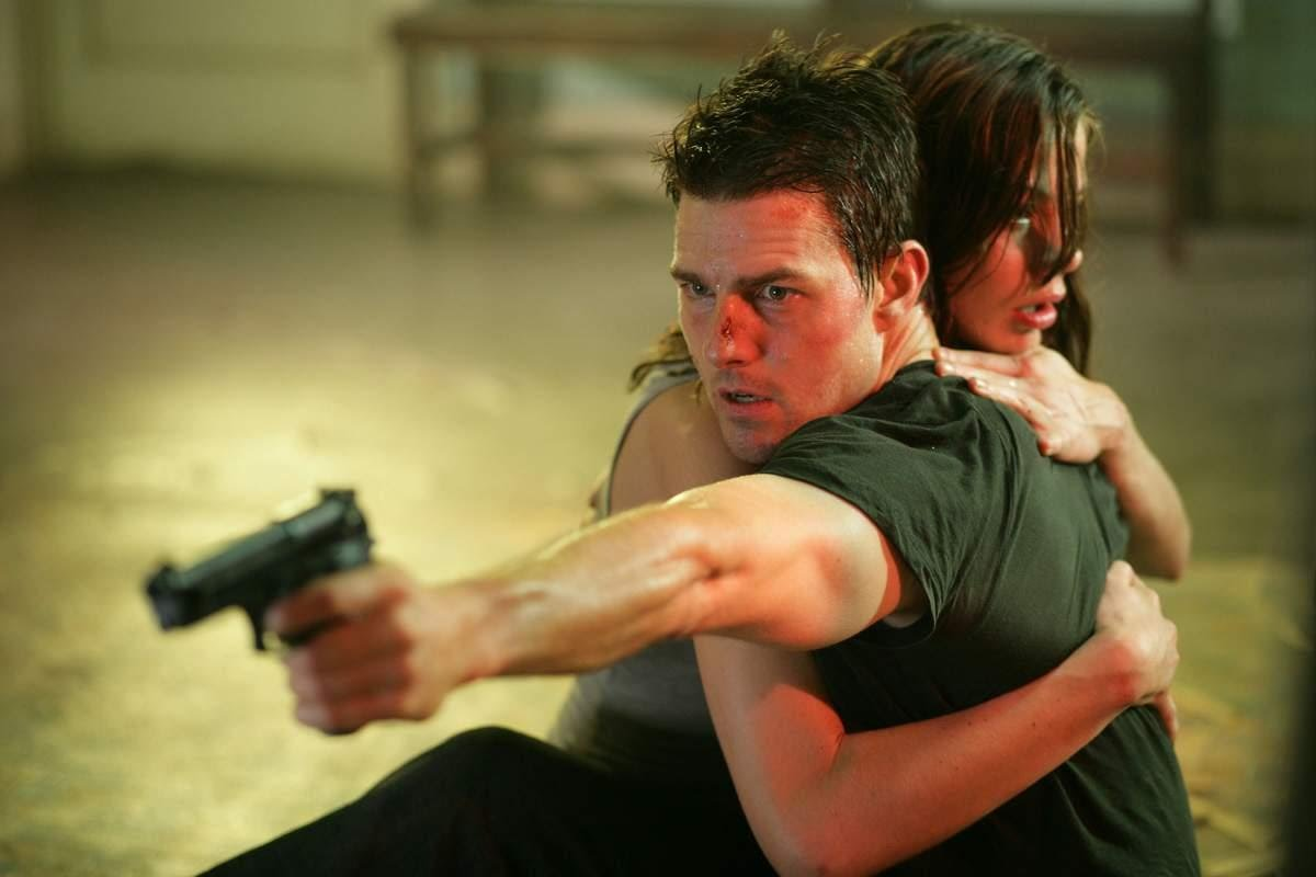 Ethan Hunt (Tom Cruise) in the midst of action alongside wife Michelle Monaghan in Mission: Impossible III (2006)