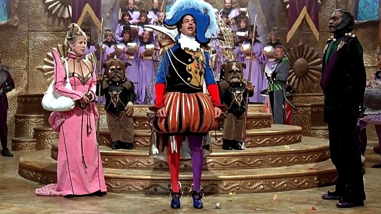 (l to r) Marge Nelson (Teri Garr), Emperor Tod Spengo (Jon Lovitz) and his general Thalmus Rasulala in Mom and Dad Save the World (1992)