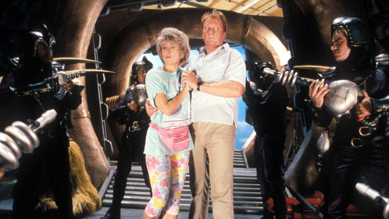 Dick and Marge Nelson (Jeffrey Jones and Teri Garr) arrive on the planet Spengo in Mom and Dad Save the World (1992)