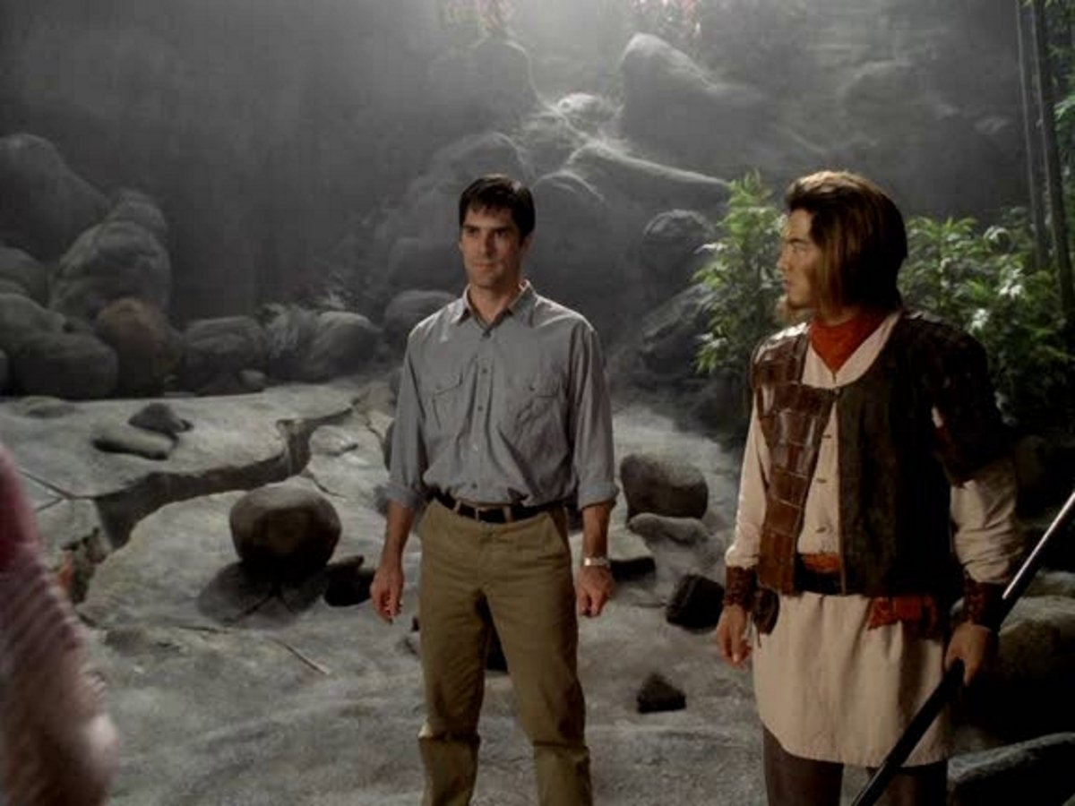 (l to r) Scholar Nicolas Orton (Thomas Gibson) and The Monkey King (Russell Wong) in The Monkey King (2001)
